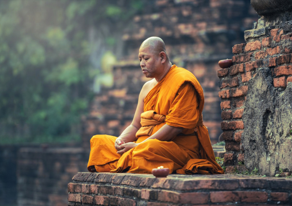 A Monk meditating at a relic site