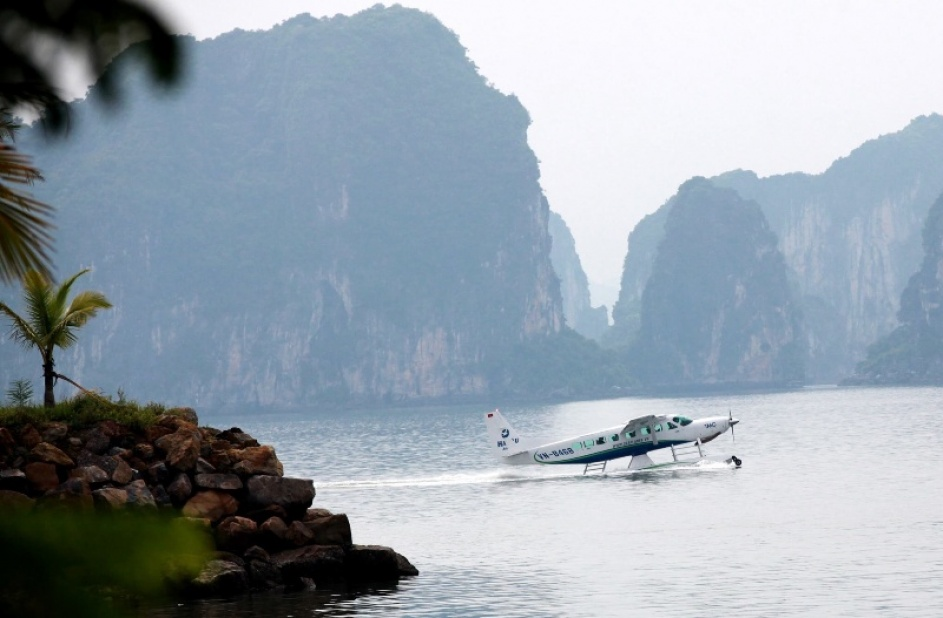 Seaplane land on water at Halong Bay