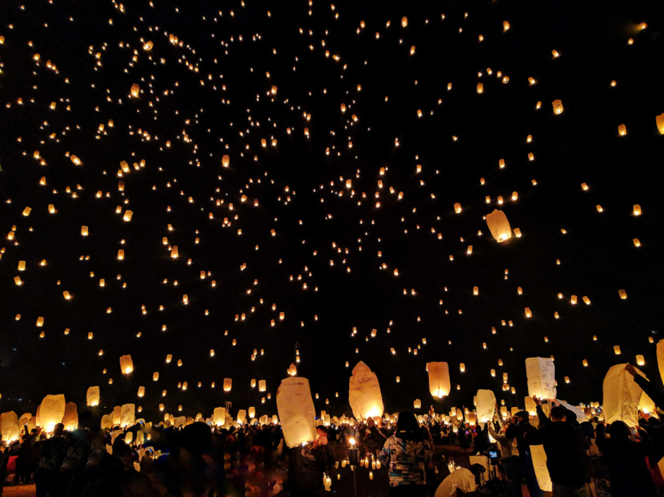 Thousands of glowing lanterns light up the night sky