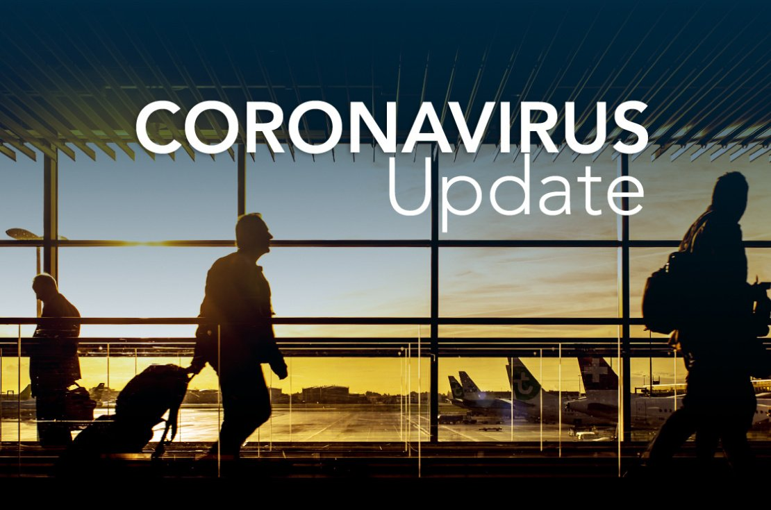 """White text saying """"CORONAVIRUS Update"""" above men with suitcases at the airport"""